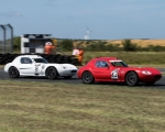 Ben McFall (43) leads Sean McGovern into Colonial 1 in the Ginetta Junior race(S3)