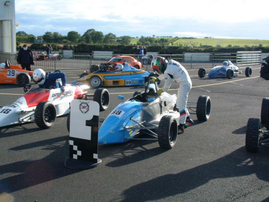 FF1600 winner Morgan Quinn exiting car.